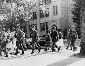 U.S. Troops escort African American students from Central High School, Little Rock, Arkansas, October 3, 1957. Gelatin silver print. New York World-Telegram & Sun Collection, Prints and Photographs Division, Library of Congress